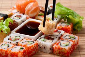 Traditional Japanese food Sushi. Closeup japanese sushi on a bamboo napkin. Sushi collection